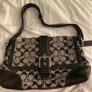 black and grey coach purse,